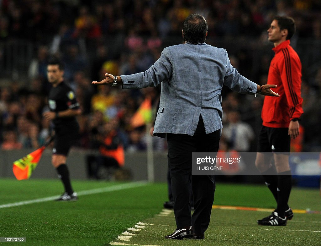 Barcelona's Argentinian coach Gerardo 'Tata' Martino reacts during the Spanish league football match FC Barcelona vs Real Valladolid CF at the Camp Nou stadium in Barcelona on October 5, 2013.