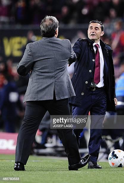 Barcelona's Argentinian coach Gerardo 'Tata' Martino shakes hands with Athletic Bilbao's coach Ernesto Valverde during the Spanish league football...