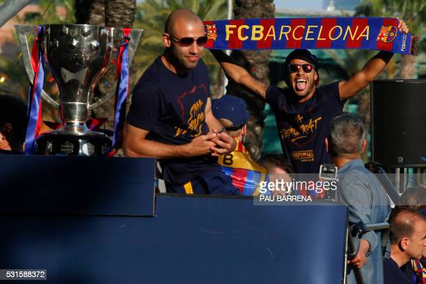 TOPSHOT Barcelona's Argentinian defender Javier Mascherano and Barcelona's Brazilian forward Neymar parades on a bus with their teammates through the...