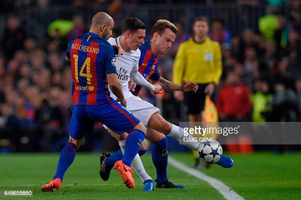 TOPSHOT Barcelona's Argentinian defender Javier Mascherano and Barcelona's Croatian midfielder Ivan Rakitic vie with Paris SaintGermain's German...