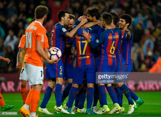 Barcelona's Argentinian defender Javier Mascherano celebrates with teammates after scoring a penalty goal during the Spanish league football match FC...