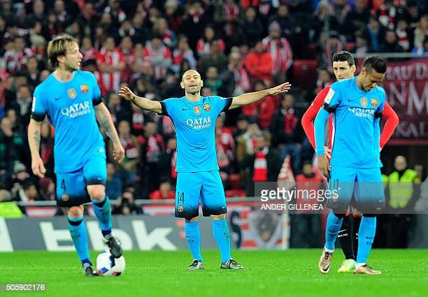 Barcelona's Argentinian defender Javier Mascherano shouts instructions to teammates Croatian midfielder Ivan Rakitic and Brazilian forward Neymar da...