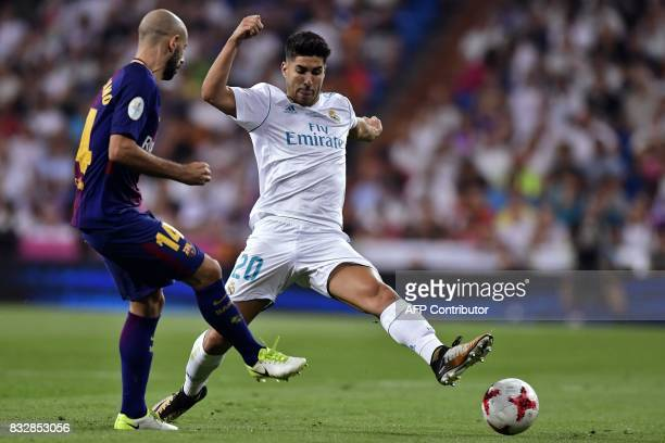 Barcelona's Argentinian defender Javier Mascherano vies with Real Madrid's midfielder Marco Asensio during the second leg of the Spanish Supercup...