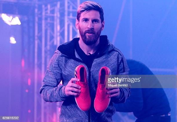 Barcelona's Argentinian forward Lionel 'Leo' Messi poses with the new Messi 16 boots by Adidas on November 24 2016 in Barcelona Spain