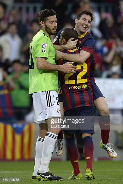 Barcelona's Argentinian forward Lionel Messi and Barcelona's Brazilian defender Dani Alves celebrate after scoring a goal during the Spanish league...