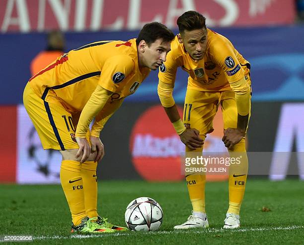 Barcelona's Argentinian forward Lionel Messi and Barcelona's Brazilian forward Neymar prepare to kick a ball during the Champions League quarterfinal...