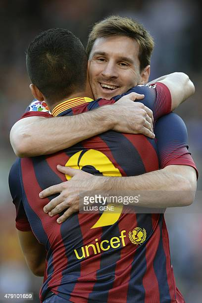 Barcelona's Argentinian forward Lionel Messi and Barcelona's Chilean forward Alexis Sanchez celebrate after scoring during the Spanish league...