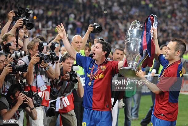 Barcelona´s Argentinian forward Lionel Messi and Barcelona´s midfielder Andres Iniesta celebrate with the Champions League Cup afte the trophy...