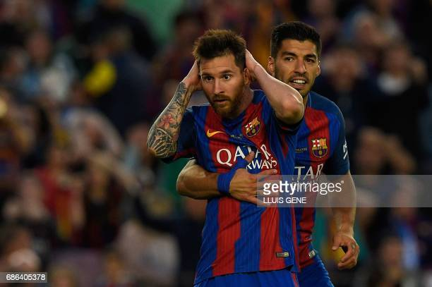 TOPSHOT Barcelona's Argentinian forward Lionel Messi and Barcelona's Uruguayan forward Luis Suarez gesture during the Spanish league football match...