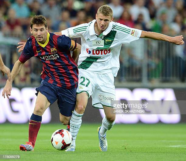 Barcelona's Argentinian forward Lionel Messi and Lechia Gdansk's midfielder Pawel Dawidowicz vie for the ball during their preseason friendly...