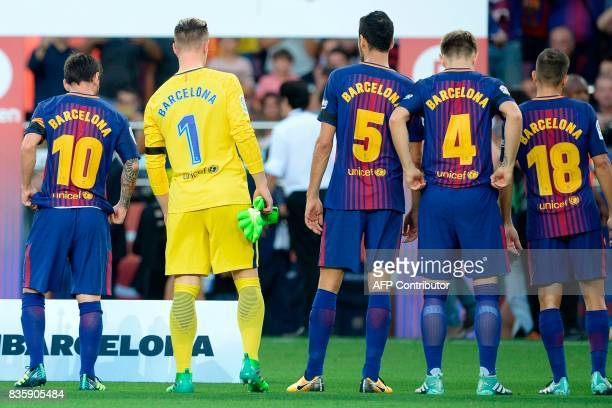 Barcelona's Argentinian forward Lionel Messi and teammates stand with jerseys reading 'Barcelona' instead of their names to pay tribute to the...