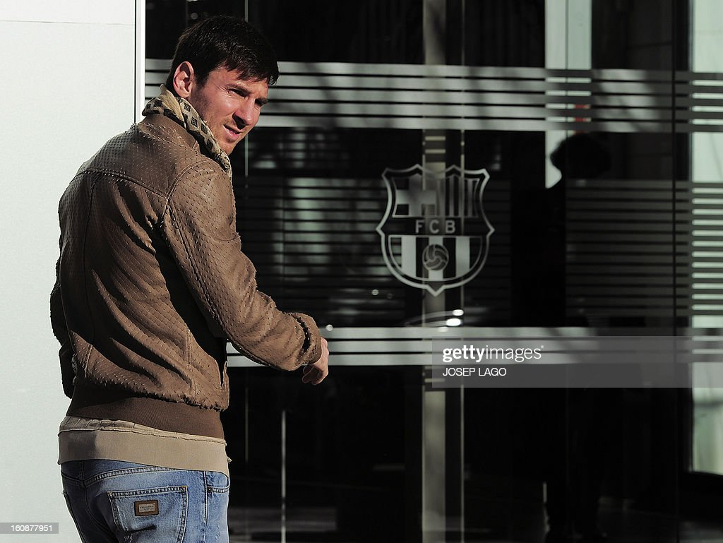 Barcelona's Argentinian forward Lionel Messi arrives at the Camp Nou stadium in Barcelona to sign a new contract on February 7, 2013. Barcelona superstar Lionel Messi will sign a new contract today tying him to the Catalan club until 2018.