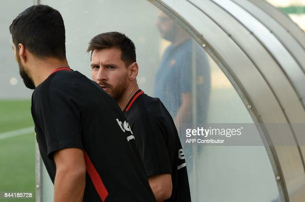 Barcelona's Argentinian forward Lionel Messi arrives for a training session at the Sports Center FC Barcelona Joan Gamper in Sant Joan Despi near...