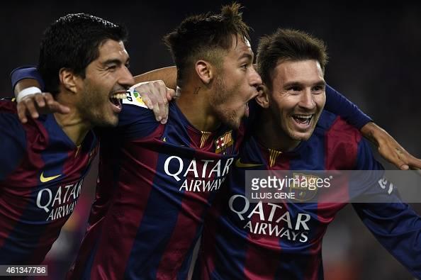 Barcelona's Argentinian forward Lionel Messi Barcelona's Brazilian forward Neymar da Silva Santos Junior and Barcelona's Uruguayan forward Luis...