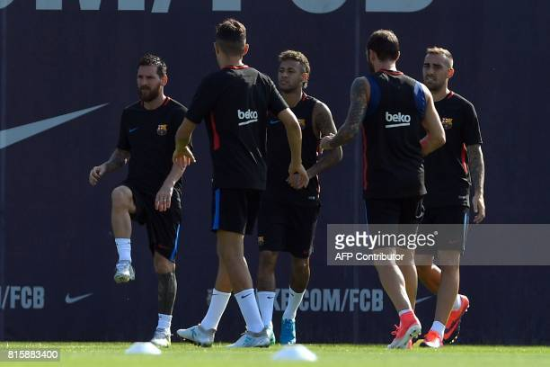 Barcelona's Argentinian forward Lionel Messi Barcelona's Brazilian forward Neymar and Barcelona's forward Paco Alcacer warm up during a training...