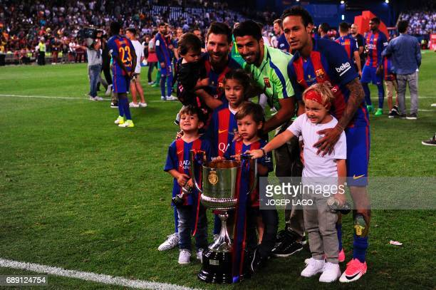 Barcelona's Argentinian forward Lionel Messi Barcelona's Uruguayan forward Luis Suarez Barcelona's Brazilian forward Neymar and their kids pose with...