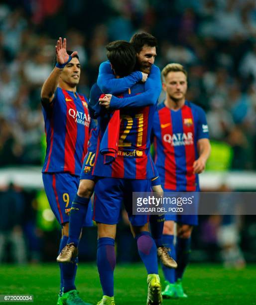 Barcelona's Argentinian forward Lionel Messi Cback celebrates with Barcelona's Portuguese midfielder Andre Gomes after scoring during the Spanish...