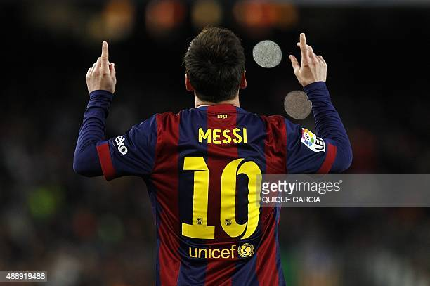 Barcelona's Argentinian forward Lionel Messi celebrates a goal during the Spanish league football match FC Barcelona v UD Almeria at the Camp Nou...