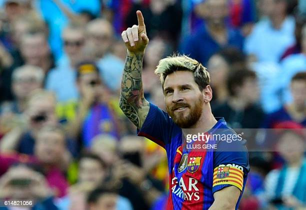 Barcelona's Argentinian forward Lionel Messi celebrates a goal during the Spanish league football match FC Barcelona vs RC Deportivo de la Coruna at...