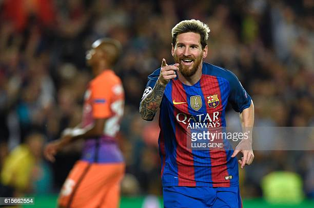 TOPSHOT Barcelona's Argentinian forward Lionel Messi celebrates a goal during the UEFA Champions League football match FC Barcelona vs Manchester...