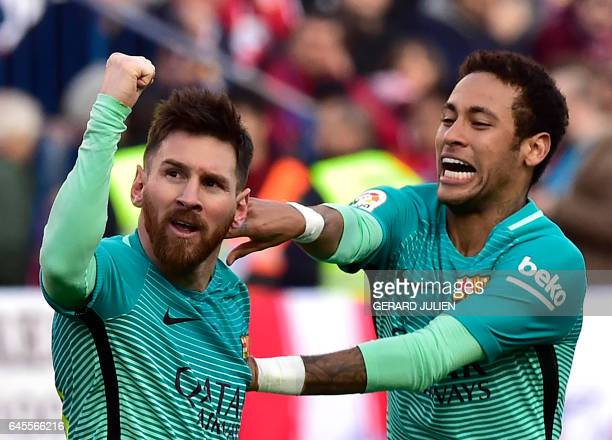 Barcelona's Argentinian forward Lionel Messi celebrates a goal with Barcelona's Brazilian forward Neymar during the Spanish league football match...
