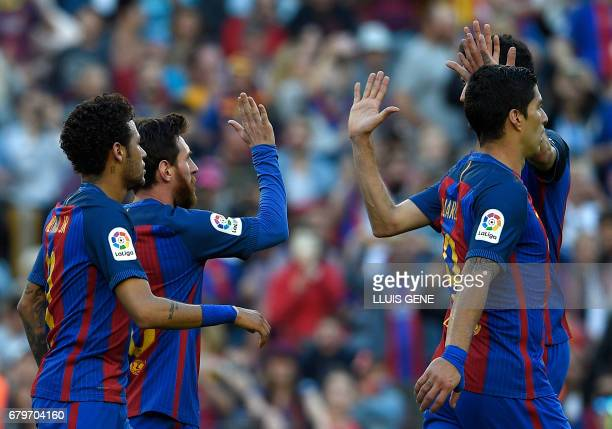 Barcelona's Argentinian forward Lionel Messi celebrates a goal with teammates during the Spanish league football match FC Barcelona vs Villarreal CF...