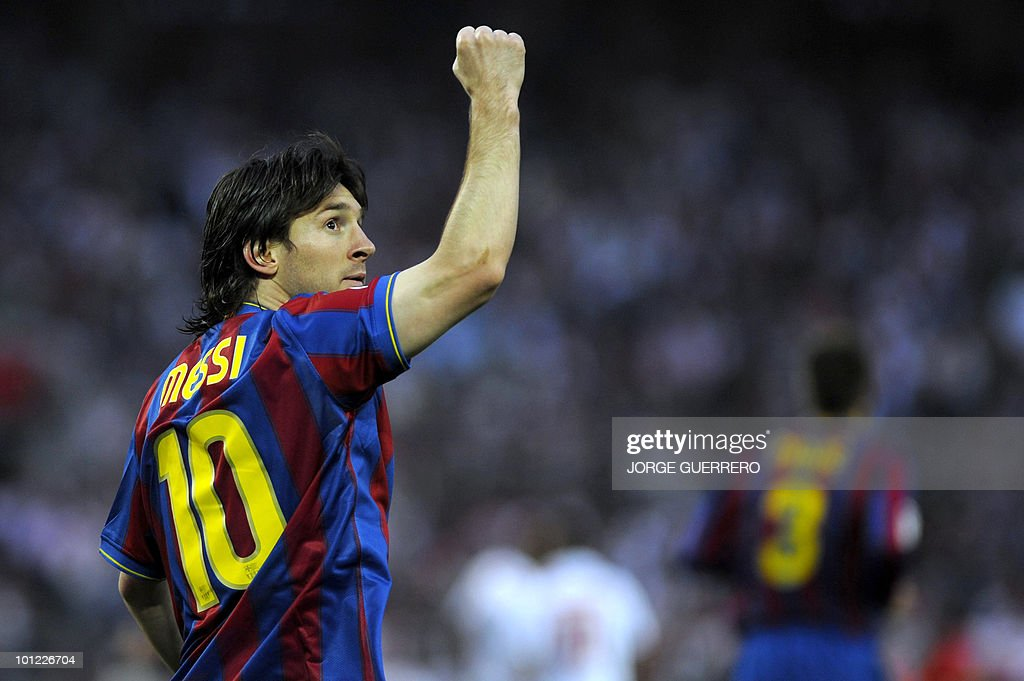 Barcelona's Argentinian forward Lionel Messi celebrates after scoring against Sevilla during a Spanish league football match at Ramon Sanchez Pizjuan stadium on May 8, 2010.