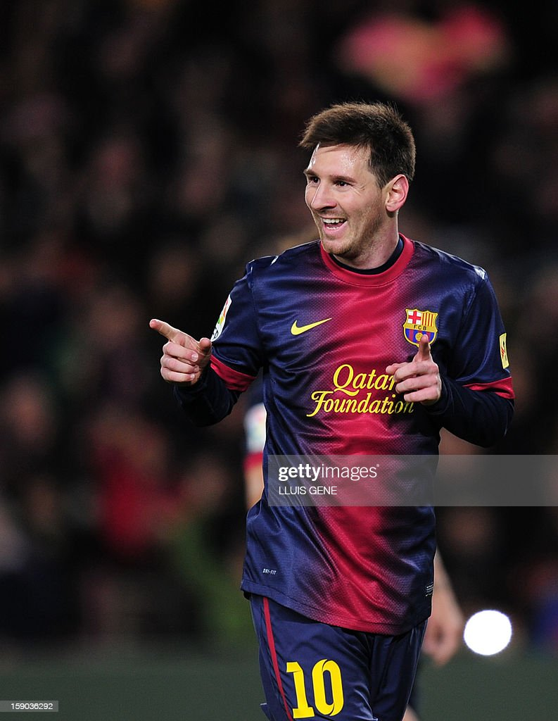 Barcelona's Argentinian forward Lionel Messi celebrates after scoring on a penalty kick during the Spanish league football match FC Barcelona vs RCD Espanyol at the Camp Nou stadium in Barcelona on January 6, 2013.
