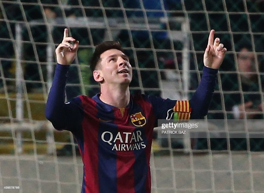 Barcelona's Argentinian forward Lionel Messi celebrates after scoring his thrid goal during their UEFA Champions League football match against Apoel...