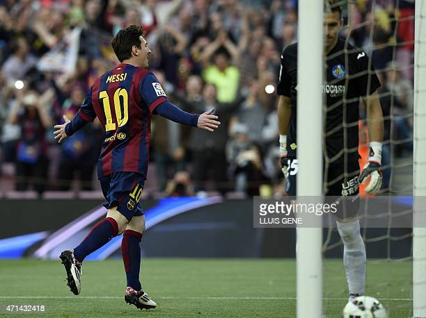 Barcelona's Argentinian forward Lionel Messi celebrates after scoring a goal during the Spanish league football match FC Barcelona vs Getafe at the...