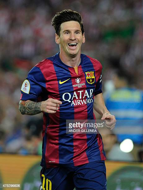 Barcelona's Argentinian forward Lionel Messi celebrates after scoring his team's third goal during the Spanish Copa del Rey final football match...