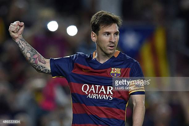 Barcelona's Argentinian forward Lionel Messi celebrates after scoring a goal on a penalty kick during the Spanish league football match FC Barcelona...