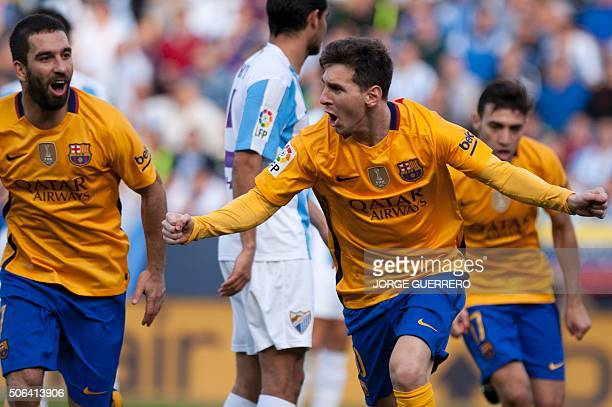 Barcelona's Argentinian forward Lionel Messi celebrates after scoring during the Spanish league football match Malaga CF vs FC Barcelona at La...