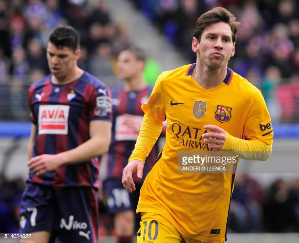Barcelona's Argentinian forward Lionel Messi celebrates after scoring during the Spanish league football match SD Eibar vs FC Barcelona at the Ipurua...