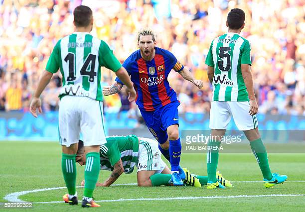 TOPSHOT Barcelona's Argentinian forward Lionel Messi celebrates after scoring during the Spanish league football match FC Barcelona vs Real Betis...