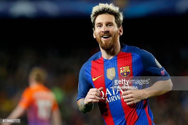 Barcelona's Argentinian forward Lionel Messi celebrates after scoring his second goal during the UEFA Champions League football match FC Barcelona vs...