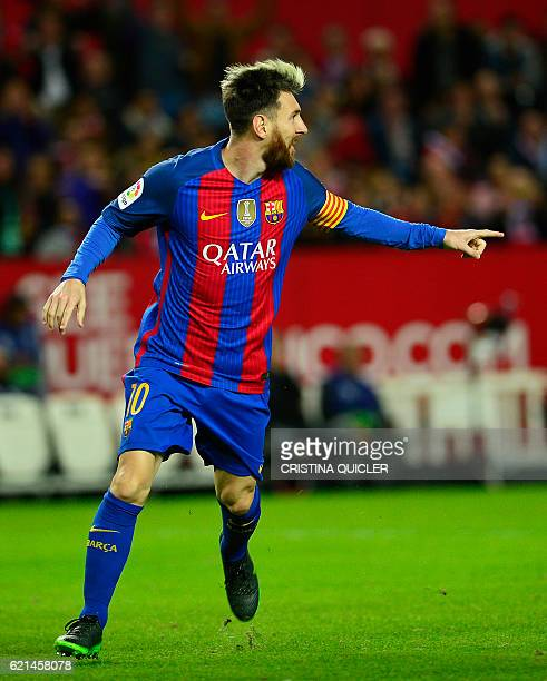 Barcelona's Argentinian forward Lionel Messi celebrates after scoring during the Spanish league football match Sevilla FC vs FC Barcelona at the...