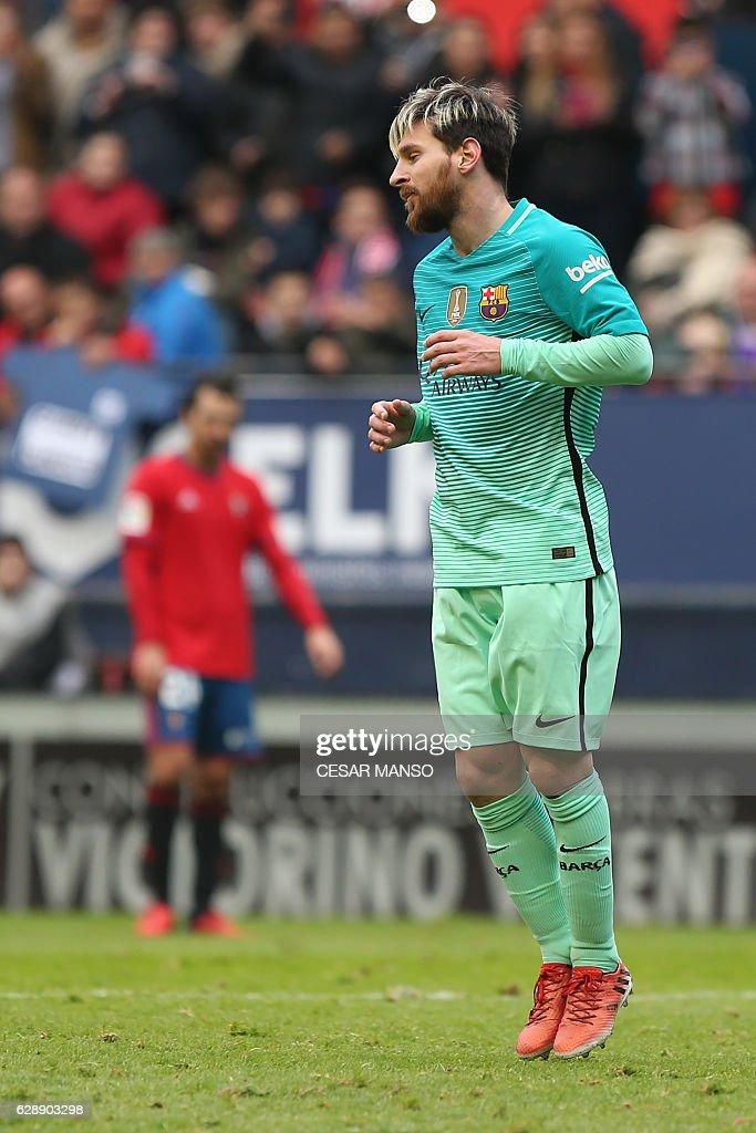 Barcelona's Argentinian forward Lionel Messi celebrates after scoring during the Spanish league football match CA Osasuna vs FC Barcelona at the Reyno de Navarra (El Sadar) stadium in Pamplona on December 10, 2016. / AFP / CESAR