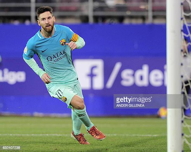 Barcelona's Argentinian forward Lionel Messi celebrates after scoring his team's second goal during the Spanish league football match SD Eibar vs FC...