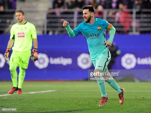 TOPSHOT Barcelona's Argentinian forward Lionel Messi celebrates after scoring his team's second goal during the Spanish league football match SD...