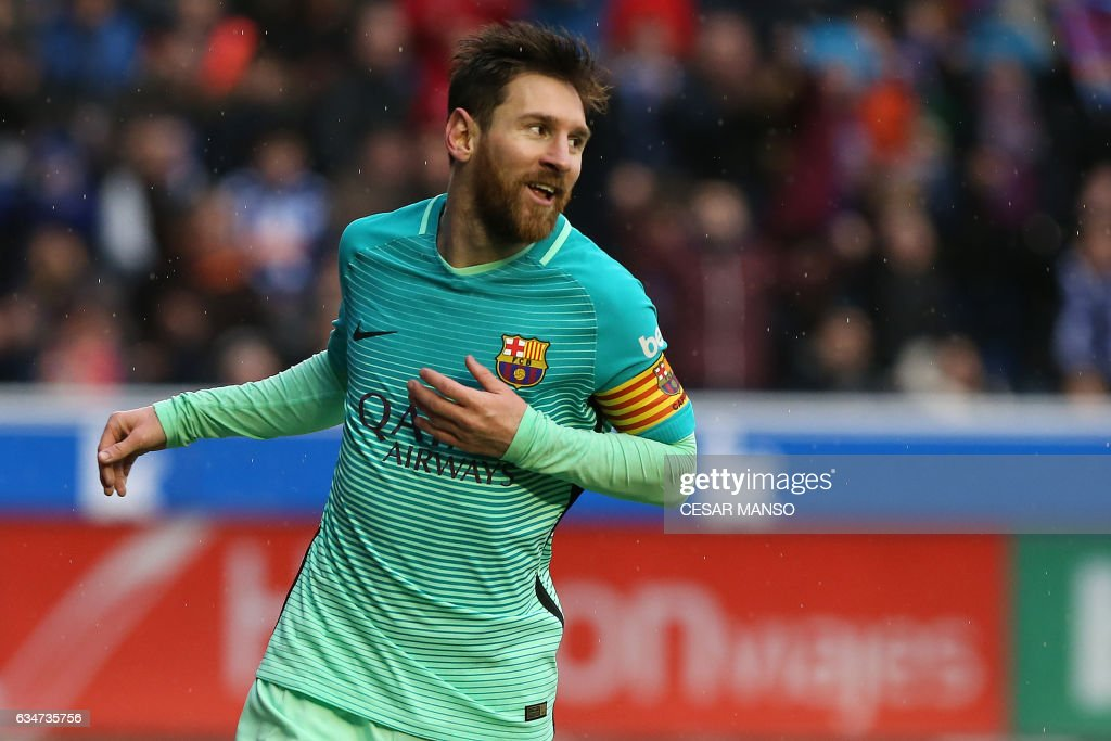 TOPSHOT - Barcelona's Argentinian forward Lionel Messi celebrates after scoring during the Spanish league football match Deportivo Alaves vs FC Barcelona at the Mendizorroza stadium in Vitoria on Feburary 11, 2017. /