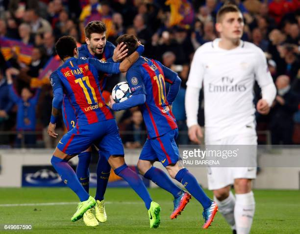 Barcelona's Argentinian forward Lionel Messi celebrates after scoring a goal with with Barcelona's Brazilian forward Neymar and Barcelona's defender...