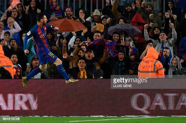 Barcelona's Argentinian forward Lionel Messi celebrates after scoring during the Spanish league football match FC Barcelona vs Sevilla FC at the Camp...