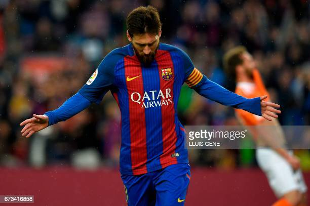 TOPSHOT Barcelona's Argentinian forward Lionel Messi clebrates after scoring a goal during the Spanish league football match FC Barcelona vs CA...