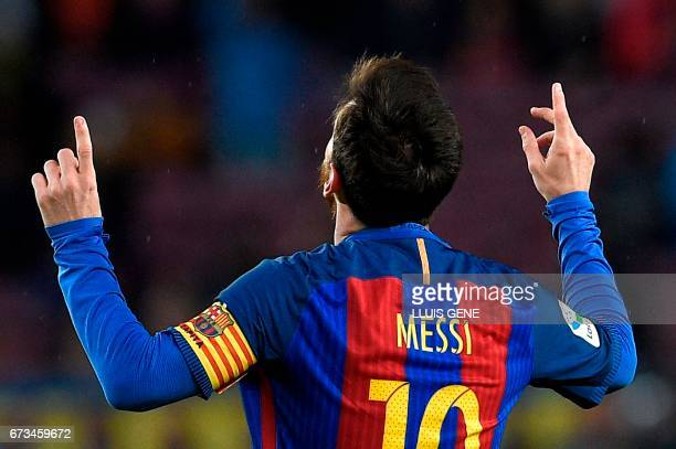 TOPSHOT Barcelona's Argentinian forward Lionel Messi celebrates after scoring a goal during the Spanish league football match FC Barcelona vs CA...