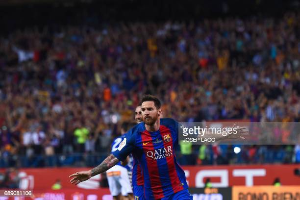 Barcelona's Argentinian forward Lionel Messi celebrates after scoring the opener during the Spanish Copa del Rey final football match FC Barcelona vs...