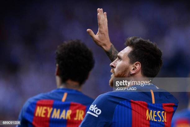 Barcelona's Argentinian forward Lionel Messi celebrates after scoring during the Spanish Copa del Rey final football match FC Barcelona vs Deportivo...
