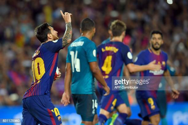 Barcelona's Argentinian forward Lionel Messi celebrates after scoring a goal following a penalty kick during the Spanish Supercup first leg football...