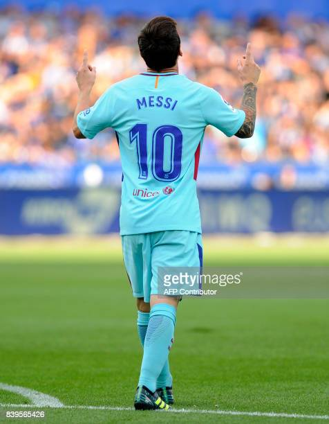 Barcelona's Argentinian forward Lionel Messi celebrates after scoring during the Spanish league football match Deportivo Alaves vs FC Barcelona at...