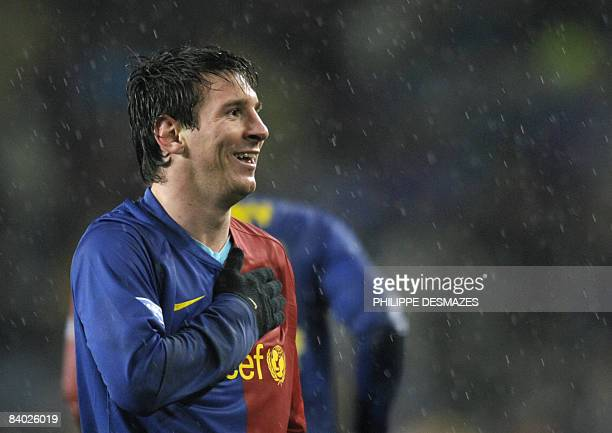 Barcelona's Argentinian forward Lionel Messi celebrates after scoring during the Spanish league football match against Real Madrid at the Camp Nou...